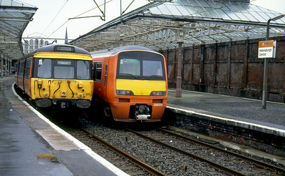 EMU's 303011 & 320311 stand at Helensburgh Central 27th August 1992.