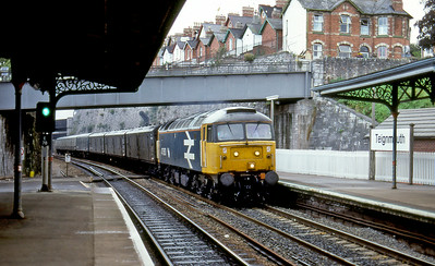 47663 heads through Teignmouth with the Plymouth to Newcastle vans. August 1988.