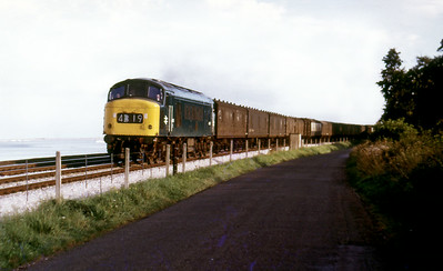 A Peak heads a northbound parcels train approaching Powderham. Date unknown.