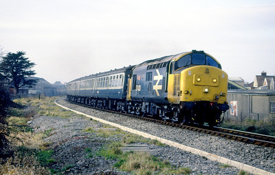 37430 'Cwmbran' powers past the SWEB yard on the exit from Weston-super-Mare with a Taunton to Bristol service. 1980's.