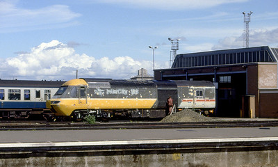An HST power car gets rubbed down prior to a repaint outside Bristol Bath Road Depot. 1980's.