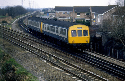 A strange 1st generation DMU combination comes off the W-s-Mare loop line at Worle Junction. It even has Paignton in the destination blind when heading for Bristol! 1980's.
