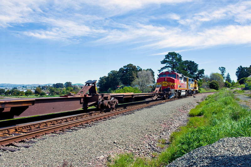 The O11 moves eastbound past the switch (where the power is) and will back into the Gately siding.