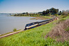 An Amtrak San Joaquins rounds the bend on the Cal-P heading to Emeryville. This unique location at Gately (in Pinole, California) offers views of the Union Pacific, Amtrak, and on the other side, the Burlington Northern Santa Fe.