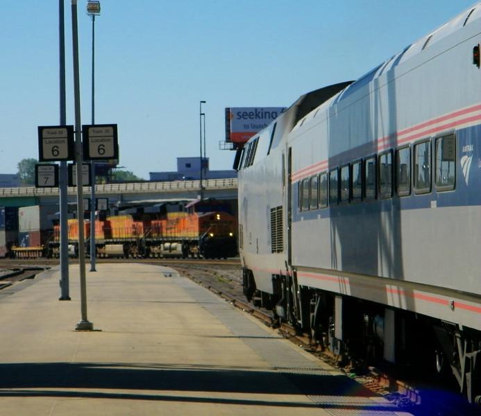 An eastbound BNSF intermodal stack train approaches KCY as River Runner train 311 waits its turn.