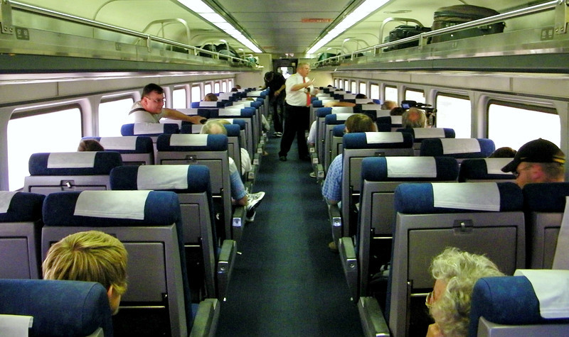 Amtrak Unlimited Gatherers had this Horizon coach - last in Lincoln Service 313's consist - pretty much to ourselves during the run back to STL.  The conductor was a real hoot, telling humorous anecdotes and generally keeping the small but boisterous mob entertained.  Let's see... I can spot Joe (can't seem to fit into his seat on the left), Alice, Anthony, Alan; others in the shot were with us, but names escape me.