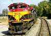 Sure enough, here's the train - a manifest freight job with Kansas City Southern power in two different liveries on the nose - that set off the bells, lights, and gates at the grade crossing beside the Amtrak station at Bloomington-Normal (home of BEER NUTS!!).