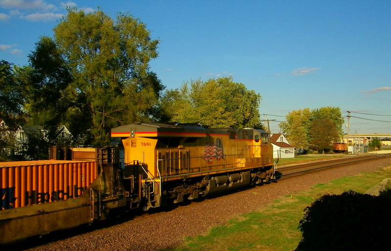 "The ""Kodak color"" really stands out in this view of a passing intermodal stack train."