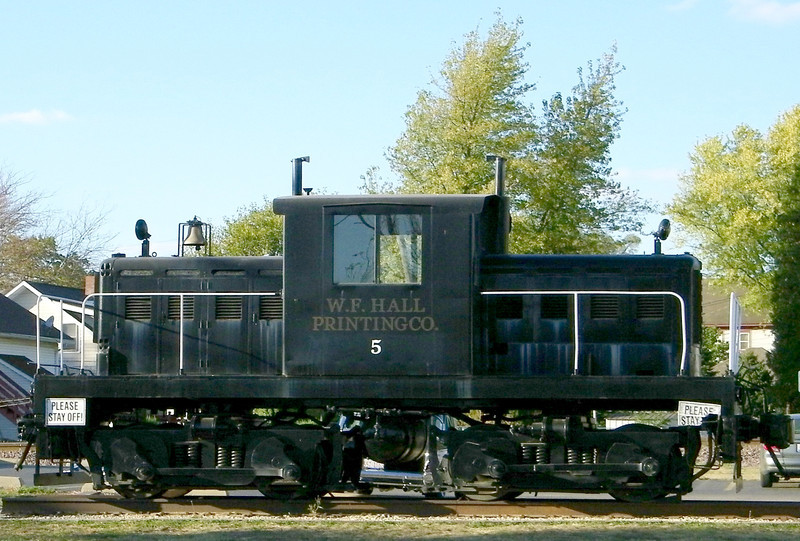 Early diesel locomotive, with mechanical transmission and wheels power-coupled using rods and counterweights similar to a steam engine.