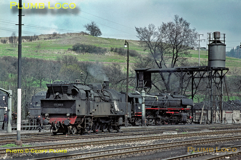 View of part of the loco depot at Rottweil from the station, T18 class 4-6-4T No. 078 246-6 being nearest the camera. The tender of 2-10-0 No. 044 483-8 can just be seen by the turntable and classmate 044 375-4 stands by the water column. Monday 4th May 1970. Slide No. 4848.