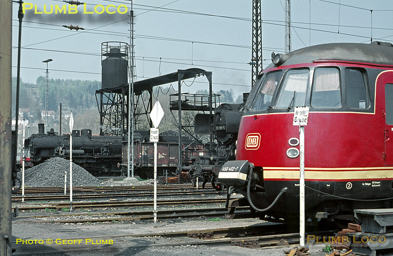 In the foreground is a streamlined EMU, 456 402-7, in DB red livery, beyond is 2-10-0 No. 051 681-5 and P8 038 791-0, all stabled on shed at Tübingen depot between duties. Wednesday 6th May 1970. Slide No. 4980.
