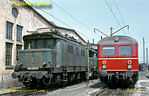 DB Bo-Bo freight electric No. 144 020-5 stands with a classmate alongside Tübingen shed, flanked by an EMU in red passenger livery, Wednesday 6th May 1970. Slide No. 4987.