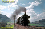 Prussian P8 4-6-0 No. 038 711-8 climbs the 1 in 48 gradient from Laufen (in the background) up to Lautlingen with a train from Tübingen to Sigmaringen along the scenic line through the Schwäbischen Alb. Thursday 7th May 1970. Slide No. 5016.