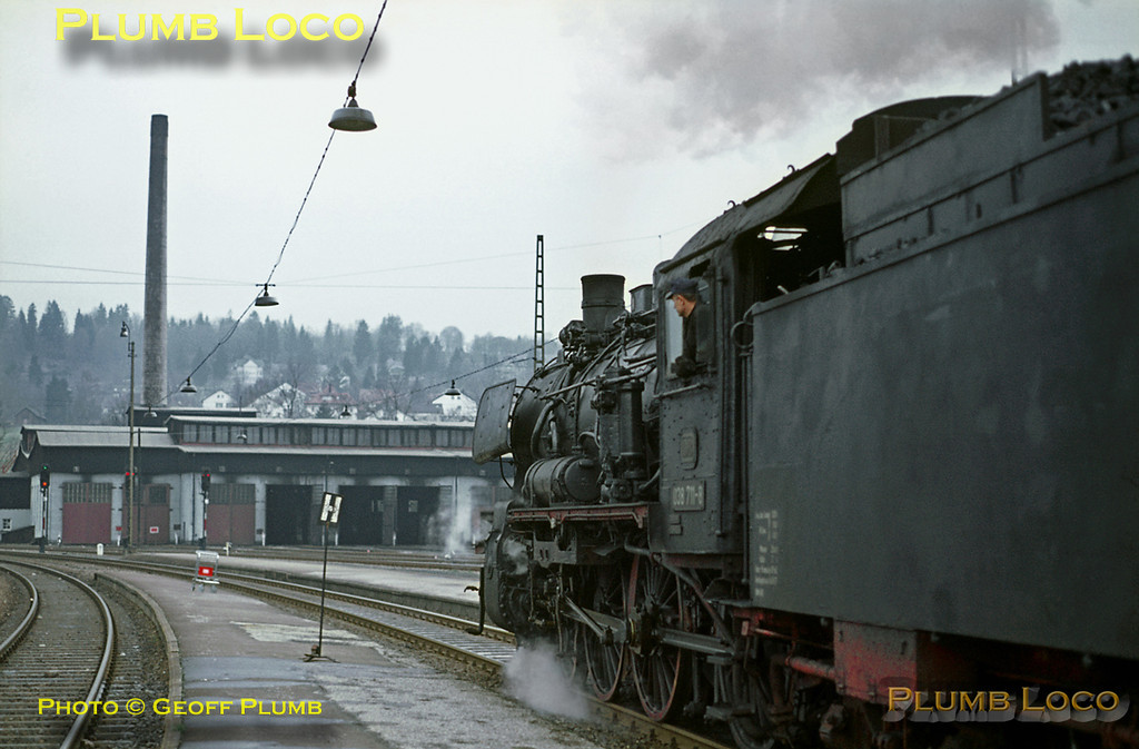 038 711-8 has worked the 08:00 train from Horb to Freudenstadt and is now departing for Offenburg and Freiburg at 08:47. How far the P8 worked the train I do not know... Wednesday 6th May 1970. The loco shed can be seen in the background. Slide No. 4943.