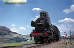 Prussian P8 4-6-0 No. 038 039-4 drifts down the grade from Lautlingen towards Laufen as it works light engine back to Tübingen amid the hills of the Schwäbischen Alb, rising here to 964 metres above sea level (3205 feet). It had earlier piloted a special train up the gradients to Ebingen, and has now been turned at the shed there to return to home depot. Thursday 7th May 1970. Slide No. 5015.