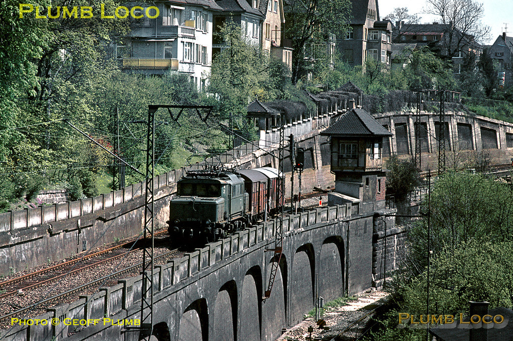 """DB """"Crocodile"""" Co-Co electric No. 193 004-9 works south past Ulm's north signalbox with a minuscule two wagon freight train on the morning of Saturday 9th May 1970. Built between 1933-1939, three of this class are now preserved. Slide No. 5084."""