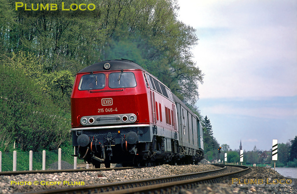 Developed from the Class 216 and forerunner of Class 218, DB Class 215 diesel-hydraulic Bo-Bo No. 215 046-4 heads south from Ulm alongside the River Danube with a train bound for Friedrichshafen on the afternoon of Saturday 9th May 1970. Slide No. 5098.