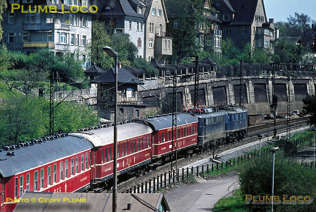 As I did not know this was running, I was not in the ideal position to get a shot! A special of some sort, it consisted of three sleeping-cars at the front of the train, then six restaurant-cars  followed by another three sleeping-cars, all in DSG livery (Deutsche Schlafwagen und Speisewagen Gesellschaft). The train is heading north out of Ulm passing the north signalbox, double-headed by what looks like one of the old 118 class electrics and a class 110. Quite a train! Saturday 9th May 1970. Slide No. 5083.
