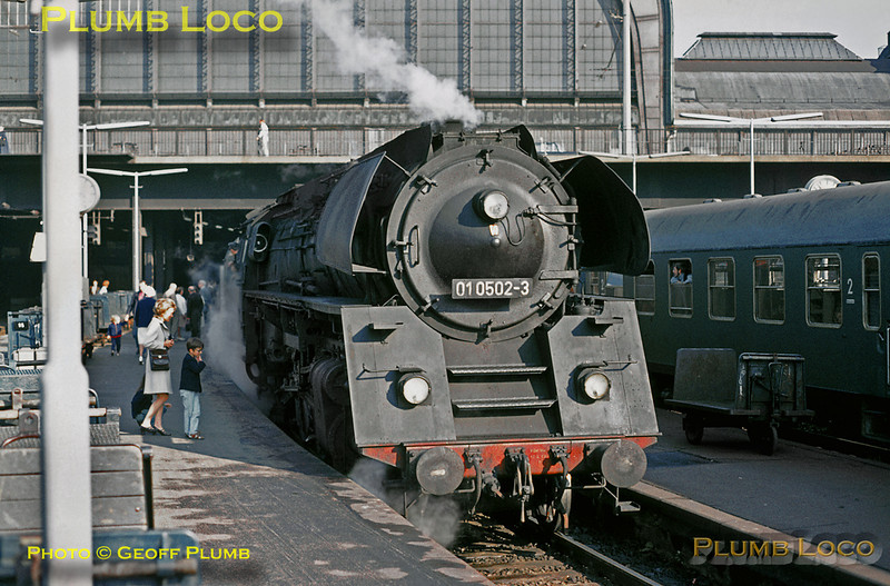 East meets West at Hamburg Hauptbahnhof - Deutsche Reichsbahn (East German) rebuilt 01/5 4-6-2 No. 01 0502-3 awaits departure time at 08:48 with train D405, the 09:00 cross-border express from Hamburg to Dresden. It worked this train as far as Schwerin, where the train reversed. The magnificent engine has a few young admirers! Saturday 11th September 1971. Slide No. 7451.