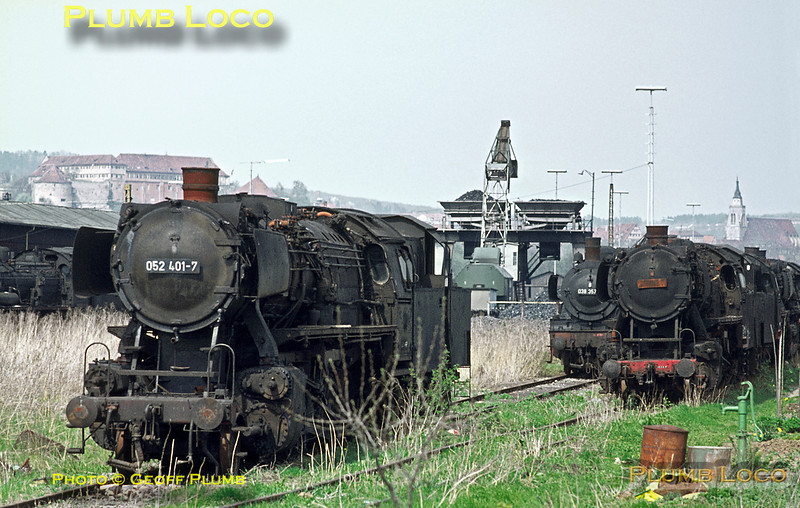 As with most engine sheds, Tübingen had its graveyard of dumped locos rusting away. Overlooked by the castle on the hillside, several class 50 2-10-0s, including 052 401-7, and a couple of P8s await their fate. Tuesday 5th May 1970. Slide No. 4903.