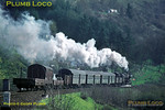 The 08:22 mixed train from Horb to Freudenstadt climbs out of the Neckar valley up to Eutingen with 2-10-0 052 953-7 slogging up the gradient with three bogie coaches and several wagons in tow. Tuesday 5th May 1970. Slide No. 4884.