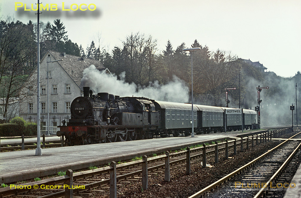 078 246-6 brings a set of six-wheeled coaches from the sidings into Rottweil station to form an early evening train to Villingen, Monday 4th May 1970. Slide No. 4861.