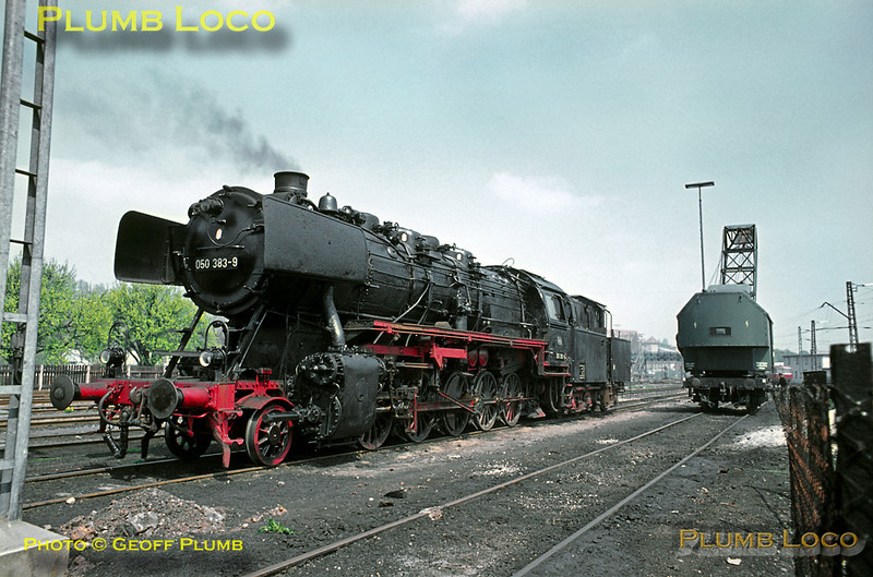 It looks as though 2-10-0 No. 050 383-9 has been through works fairly recently as it is in relatively clean condition! It is simmering in the yard at Tübingen loco shed, alongside the coaling crane. Wednesday 6th May 1970. Slide No. 4974.