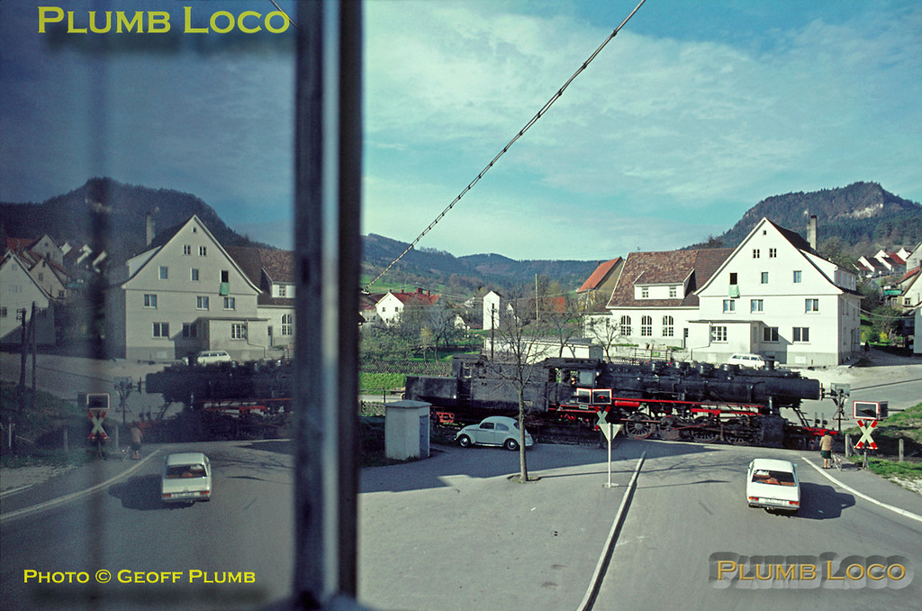 050 383-9 had worked an early morning freight train from Tübingen to Ebingen through Laufen some time previously. It has now been turned at Ebingen and is on its way back to Tübingen running light engine. It is seen from my bedroom window at the Fremdenzimmer as it runs back down the hill at Laufen, still before breakfast time... Friday 8th May 1970. Slide No. 5027.