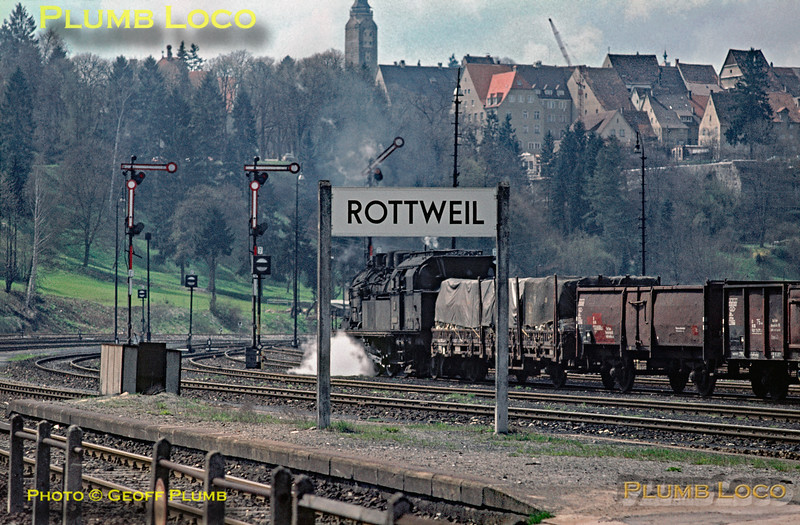 As soon as the train from Horb arrived behind 050 560-2, a freight train hauled by 078 492-x was given the road to depart northwards from Rottweil station, the town dominating the hilltop in the background. Monday 4th May 1970. Slide No. 4843.
