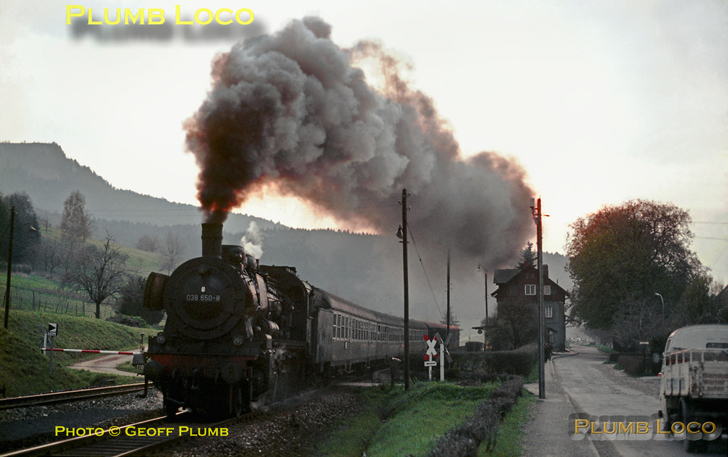 """Ex-Prussian P8 DB No. 038 650-8 restarts its train on the 1 in 48 gradient out of Laufen station, en route to Lautlingen and Sigmaringen. This was train E2076, the 17:20 """"Eilzug"""" (semi-fast passenger train) from Tübingen. This line is very scenic as it passes through the Schwäbische Albe range of prominent hills. Wednesday 6th May 1970. Slide No. 4994."""