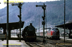 The station clock at Horb stands at 12:40 as a northbound express from Konstanz to Stuttgart arrives behind B-B diesel hydraulic No. 220 063-2 in DB maroon, black & silver livery. Meanwhile, ex-Prussian P8 4-6-0 No. 038 553-4 waits in the platform to form the 12:41 connecting train, stopping at all stations to Böblingen, Tuesday 5th May 1970. Slide No. 4895.