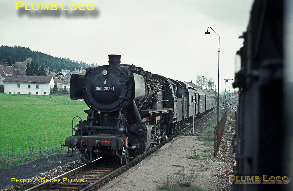 Seen from the train hauled by 078 246-6 from Rottweil to Villingen, 050 202-1 is working a train in the opposite direction, passing at a station en route, but which one I can't remember! Monday 4th May 1970. Slide No. 4865.