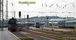 Panoramic view of Ulm Hbf with 003 246-6 on the left in the south bay waiting to depart for Biberach, while on the right a Class 110 electric in blue express livery arrives with a train from the south. Friday 8th May 1970. Slide No. 5041.