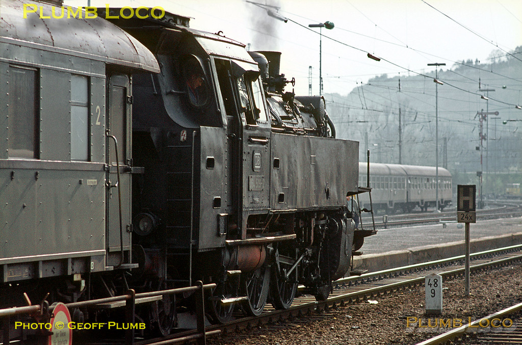 064 519-2 has now run round its train at Tübingen station and is getting ready to depart for Horb with a late afternoon stopping passenger train. Tuesday 5th May 1970. Slide No. 4912.