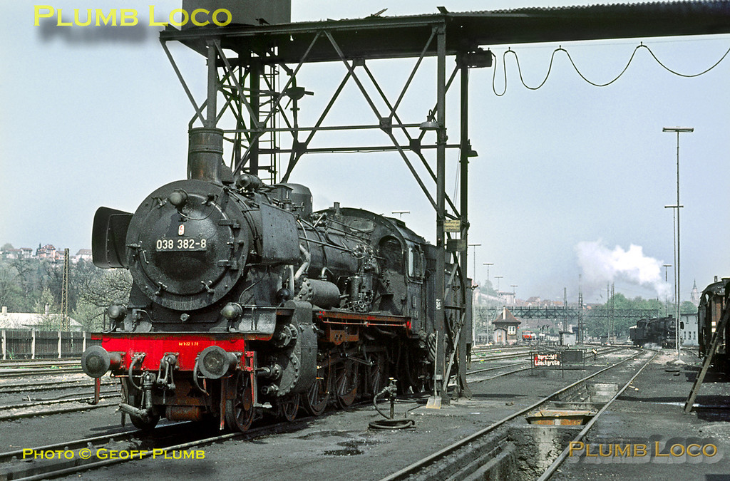 038 382-8 has just come on shed at Tübingen for servicing before its next duty, as a Class 50 2-10-0 goes off shed in the background. Wednesday 6th May 1970. Slide No. 4988.