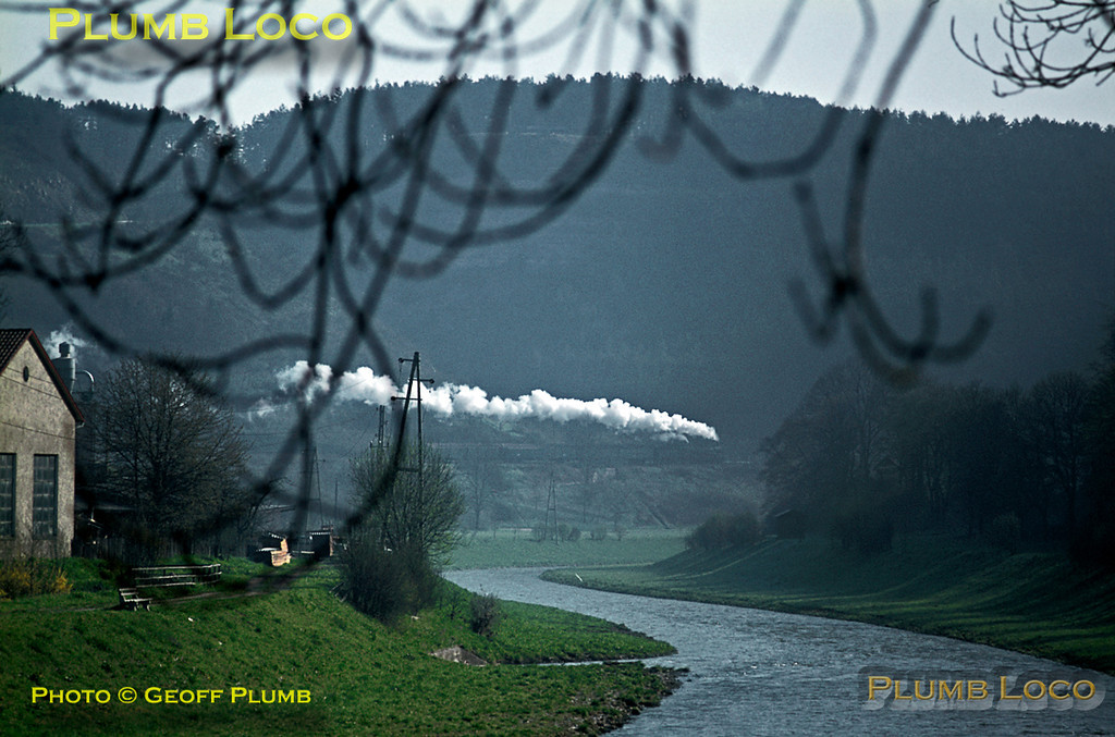 Having crossed the River Neckar a couple of minutes earlier as it departed from Horb, 038 382-8 is now climbing out of the river valley as it heads for Eutingen and Freudenstadt with the 08:00 train to Freiburg. Tuesday 5th May 1970. Slide No. 4880.