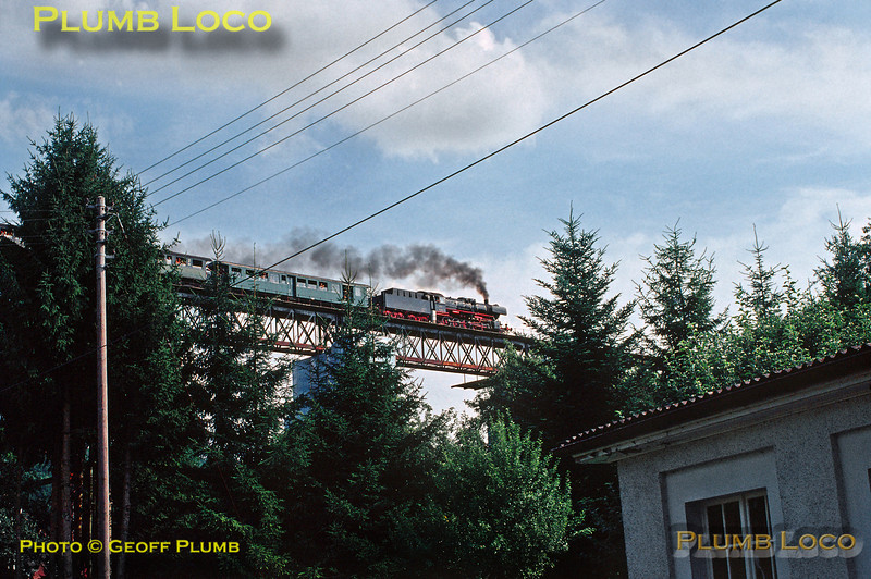 WTB 2-10-0 No. 50 2988 continues its slog from Weizen to Zollhaus-Blumberg as it crosses Epfenhofener Viadukt with the 15:55 train on the ruling 1 in 100 gradient. Wednesday 14th August 1991. Slide No. 22165.