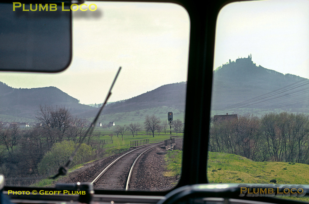 As the Uerdingen railbus from Tübingen to Ebingen works its way up into the hills of the Schwäbischen Alb, this is the view through the front windscreen looking towards the impressive Hohenzollern Castle, perched high on its mound. Wednesday 6th May 1970. Slide No. 4990.