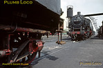 With part of 038 039-4's wonderful old style bogie tender in the foreground, a low angle shot of 064 250-4 at Tübingen engine shed on Wednesday 6th May 1970. Slide No. 4970.