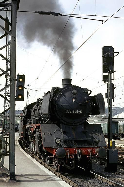 DB light Pacific of Class 03, No. 003 246-6, gets excited in the south bay platform at Ulm Hbf prior to departing with a semi-fast passenger train to Biberach on the line south to Friedrichshafen, due to leave around 15:10. Friday 8th May 1970. Slide No. 5038.