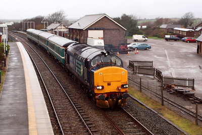 37423 leaving Ravenglass, four Mk. 2s in tow. 04/01/12.