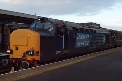 Oberlokfuhrer looks deep in thought (obviously either philosophically wondering about the meaning of life, or pondering about what to have for breakfast) as 37423 sits at Barrow. 23/01/12.