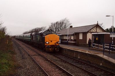 37423 draws into the platform at Ravenglass. 04/01/12.