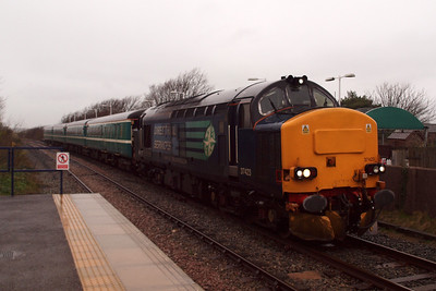 37423 pauses at Ravenglass on the trial run. 04/01/12.