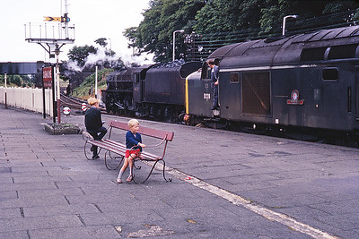 "This is me (nearest) admiring D228 ""Samaria"" at Oxenholme in the summer of 1968.  A Black 5 possibly 44735 is behind."