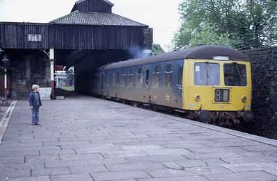 A class 105 Cravens DMU lead by M50762 leaves Oxenholme for Windermere in 1971.