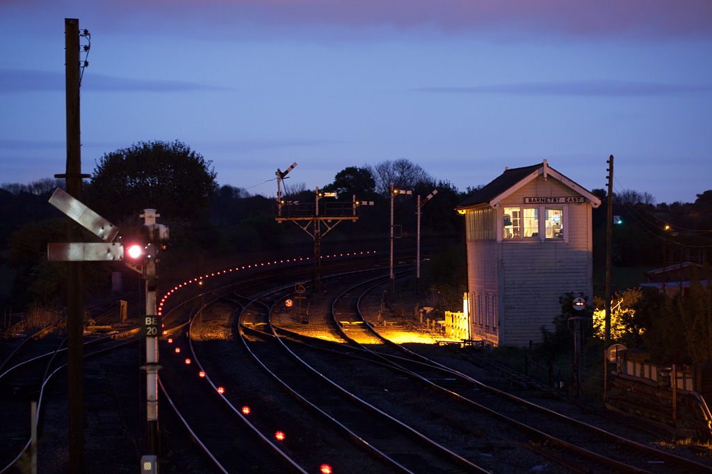 """Freight train passes Barnetby East signal box during the """"blue hour"""". Red dots are the EOT device in motion."""