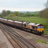 EWS 66018 leads the 4C75 13:02 Scunthorpe-Immingham empty EWS coal hoppers eastbound through Brocklesby Junction.