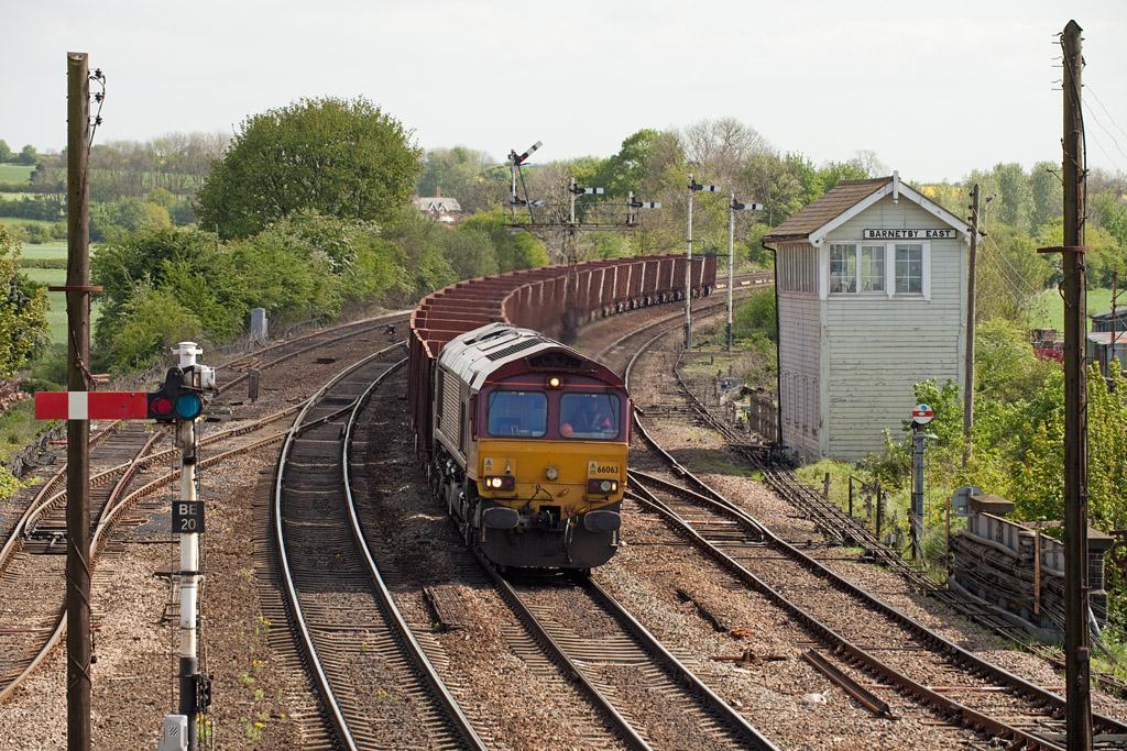 66063 brings 6T23 09:52 Immingham-Santon loaded iron ore past Barnetby East.