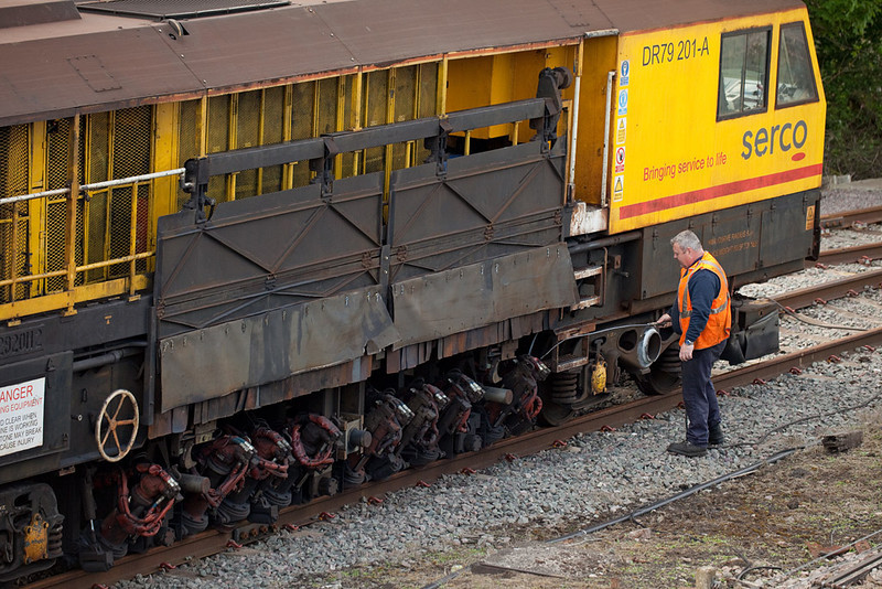 Cleaning the Serco rail grinder DR79 201 after a night's work in Barnetby.